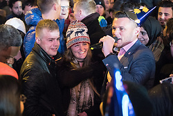 © Licensed to London News Pictures . 01/01/2017 . Manchester , UK . Marriage proposal in the crowd - pictured wife to be MALENA THIBEAULT (20) (c) and her fiance JORDAN CATTON (22) (l) with Manchester Lord Mayor CARL AUSTIN-BEHAN (r) after she accepts . Thousands gather as Manchester celebrates the start of 2017 , with a fireworks display in front of the Town Hall in Albert Square . Photo credit : Joel Goodman/LNP