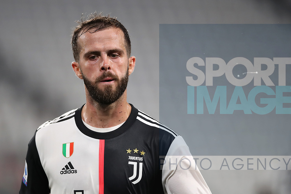 Juventus's Bosnian midfielder Miralem Pjanic spits during the Serie A match at Allianz Stadium, Turin. Picture date: 26th June 2020. Picture credit should read: Jonathan Moscrop/Sportimage