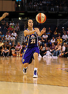 June 4, 2010; Phoenix, AZ, USA; Los Angeles Sparks guard Tisha Penicheiro makes a pass against the Phoenix Mercury during the first half at US Airways Center.  The Mercury defeated the Sparks 90-89.  Mandatory Credit: Jennifer Stewart-US PRESSWIRE