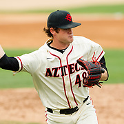 115 April 2018: San Diego State pitcher Justin Goossen-Brown (48) fields a bunt and throws to first base in the top of the third against Fullerton. The San Diego State baseball team closed out the weekend series against Cal State Fullerton with a 9-6 win at Tony Gwynn Stadium. <br /> More game action at sdsuaztecphotos.com