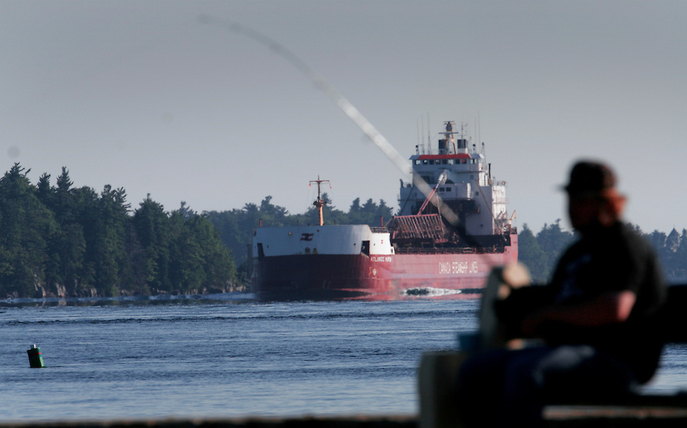 St. Lawrence, nws, lynn, 22.-The Atlantic Huron sails through the 1000 Islands area of the St. Lawrence River on its way upbound toward Lake Ontario Sunday August 6, 2005.  An early morning fisherman looks over as the giant tanker makes its way through Alexandria Bay New York.