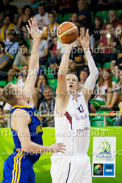 Robin Benzing #12 of Germany during basketball match between National teams of Germany and Ukraine at Day 3 of Eurobasket 2013 on September 6, 2013 in Tivoli Hall, Ljubljana, Slovenia. (Photo By Urban Urbanc / Sportida )