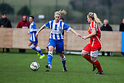 Brighton's Kirsty Barton drives past Kelly Isaac during the FA Women's Premier League match between Brighton Ladies and Cardiff City Ladies at Brighton's Training Ground, Lancing, United Kingdom on 22 March 2015. Photo by Geoff Penn.