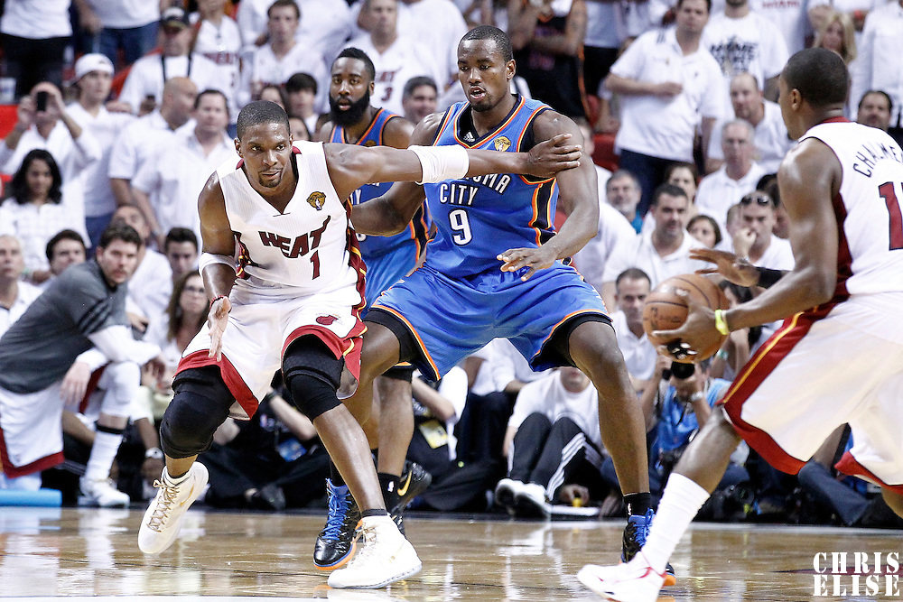 21 June 2012: Oklahoma City Thunder power forward Serge Ibaka (9) defends on Miami Heat power forward Chris Bosh (1) during the second quarter of Game 5 of the 2012 NBA Finals, at the AmericanAirlinesArena, Miami, Florida, USA.