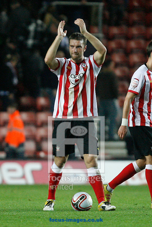 Picture by Daniel Chesterton/Focus Images Ltd. 07966 018899.19/11/11.Rickie Lambert applauds the Southampton fans with the match ball after scoring a hat-trick during the Npower Championship match at St Marys Stadium, Southampton.