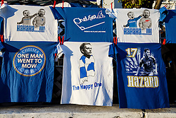 """Chelsea shirts are sold outside the ground including a """"Happy One"""" version depicting Chelsea Manager Jose Mourinho - Photo mandatory by-line: Rogan Thomson/JMP - 18/03/2014 - SPORT - FOOTBALL - Stamford Bridge, London - Chelsea v Galatasaray - UEFA Champions League Round of 16 Second leg."""