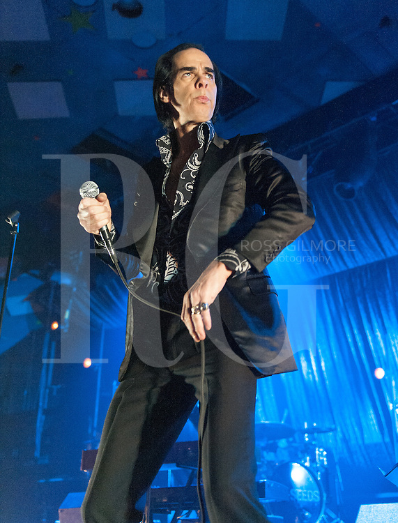 Australian singer Nick Cave of Nick Cave and The Bad Seeds perform on stage at Barrowlands Ballroom on October 31, 2013 in Glasgow