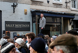 A spectator watches on from an elevated position - Mandatory byline: Robbie Stephenson/JMP - 09/02/2016 - FOOTBALL -  - Ashbourne, England - Up'Ards v Down'Ards - Royal Shrovetide Football