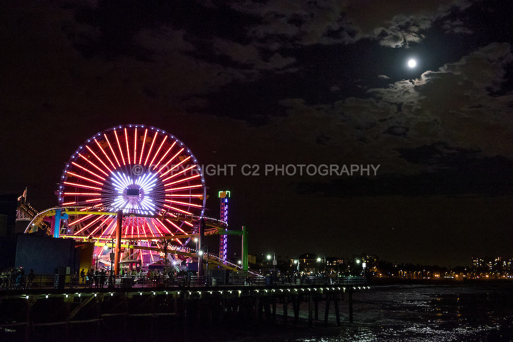 The moon lights up the Santa Monica Pier in Los Angeles, California.