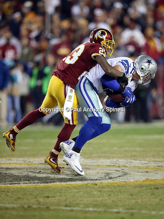 Dallas Cowboys tight end Jason Witten (82) catches a third quarter pass as he looks for yardage after the catch while carrying Washington Redskins cornerback DeAngelo Hall (23) on his back during the 2015 week 13 regular season NFL football game against the Washington Redskins on Monday, Dec. 7, 2015 in Landover, Md. The Cowboys won the game 19-16. (©Paul Anthony Spinelli)