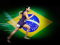 Asian woman running in front of Brazilian Flag
