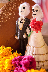 "North America, Mexico, Oaxaca Province, Oaxaca, wedding couple on display in ""ofrenda"" altar during Day of the Dead (Dias de los Muertos) celebration"