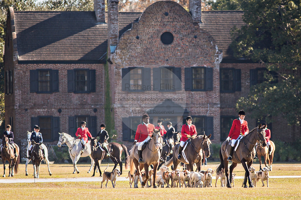 Huntsmen Jamie Green leads the hounds at the start of the first hunt of the season after the annual Blessing of the Hounds at Middleton Place Plantation November 25, 2012 in Charleston, South Carolina. Fox Hunting in South Carolina is a drag hunt which doesn't kill live foxes.
