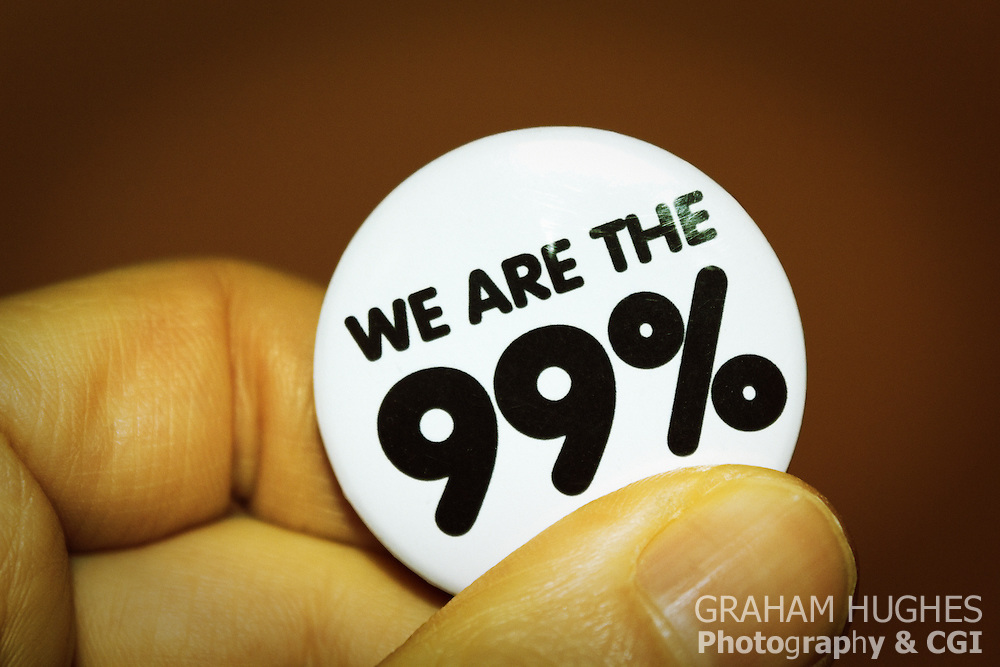 We are the 99 percent badge. For Editorial use only. Signed model release.