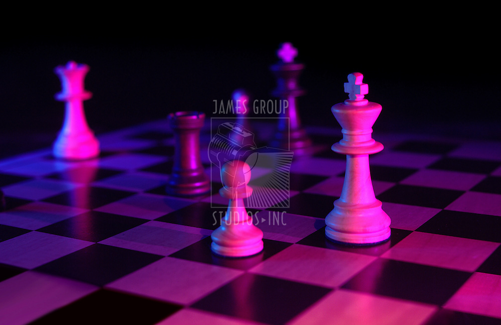 chess pieces gelled on dark background