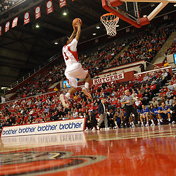 Jan 31, 2009; Piscataway, NJ, USA; Rutgers guard Mike Rosario (3) leaps for a dunk during the first half of Rutgers' 75-56 victory over DePaul in NCAA college basketball at the Louis Brown Athletic Center