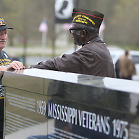 Joseph Jones, left, of Gluckstadt, and Lee Perry of Jackson, chat during the Operation Grateful Nation Saturday at the replica of the Vietnam Wall in Veterans park.  Jones and Perry have both fought for veterans returing for war and was a Past State Commander 2014-2015