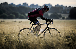 © Licensed to London News Pictures. 01/09/2019. London, UK. A cyclist enjoying the warm, bright morning on the first day of meteorological autumn in Richmond Park, west London. Photo credit: Ben Cawthra/LNP