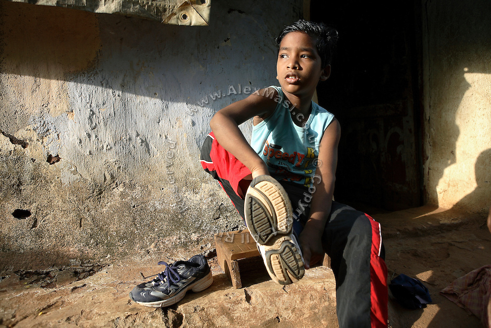 Budhia Singh,6, the famous Limca World Record marathoner, is preparing to train near his home in Salia Sahi slum (pop. 30.000) of Bhubaneswar, the capital of Orissa State, on Sunday, May 18, 2008. On May 1, 2006, Budhia completed a record breaking 65 km run from Jagannath temple, Puri to Bhubaneswar. He was accompanied by his coach Biranchi Das and by the Central Reserve Police Force (CRPF). On 8th May 2006, a Government statement had ordered that he stopped running. The announcement came after doctors found the boy had high blood pressure and cardiological stress. As of 13th August 2007 Budhia's coach Biranchi Das was arrested by Indian police on suspicion of torture. Singh has accused his coach of beating him and withholding food. Das says Singh's family are making up charges as a result of a few petty rows. On April 13, Biranchi Das was shot dead in Bhubaneswar, in what is believed to be an event unconnected with Budhia, although the police is investigating the case and has made an arrest, a local goon named Raja Archary, which is now in police custody. **Italy and China Out**