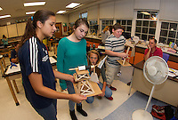 Sana Syed, Becca Camire and Katie Gagnon test out their windmill with Mr. White at Belmont Middle School during their engineering project on Wednesday morning.  (Karen Bobotas/for the Laconia Daily Sun)