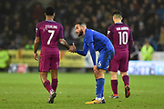 Raheem Sterling (7) of Manchester City shakes hands with Ashley Richards (6) of Cardiff City at full time after a 2-0 win over Cardiff during the The FA Cup 4th round match between Cardiff City and Manchester City at the Cardiff City Stadium, Cardiff, Wales on 28 January 2018. Photo by Graham Hunt.