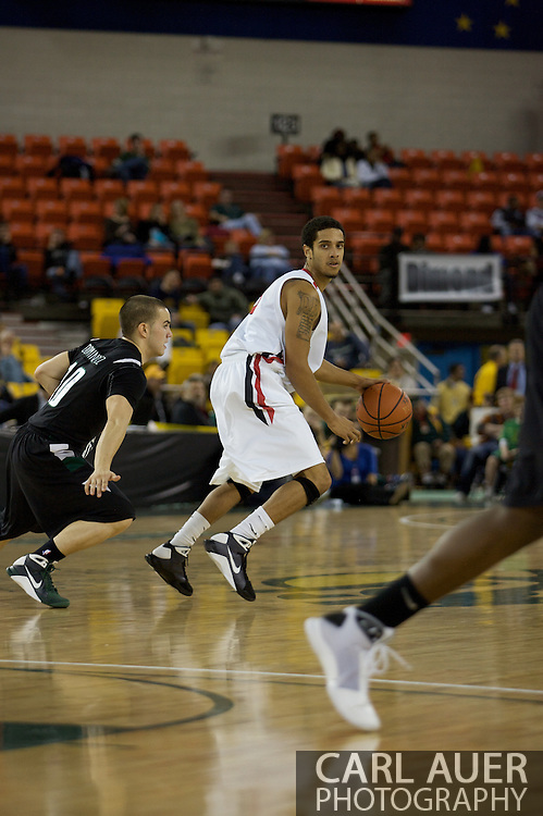 November 29th, 2008:  Anchorage, Alaska - Seattle University guard Drew Harris (31) protects the ball from Portland State guard Jeremiah Dominguez (10) in the third place game on the final day of the Great Alaska Shootout.