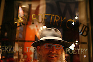 Poet Ron Whitehead hangs out in front of the sign at the Bowery Poetry Club after reading during the 2007 Howl Festival in New York City.