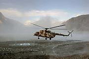 Helicopter landing on heliport in valleys of Karokoram Mountains, Skardu Valley, North Pakistan