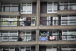 © Licensed to London News Pictures. 21/05/2020. London, UK. Residents of Trellick Tower in west London take part in 'Clap For Our Carers' by applauding NHS workers, carers and key workers from their windows, balconies and doorsteps. Government has announced a series of measures to slowly ease lockdown, which was introduced to fight the spread of the COVID-19 strain of coronavirus. Photo credit: Ben Cawthra/LNP