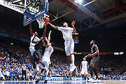 LEXINGTON, KY - DECEMBER 5: Willie Cauley-Stein #15 of the Kentucky Wildcats blocks a shot by Kendal Yancy #0 of the Texas Longhorns during the game at Rupp Arena on December 5, 2014 in Lexington, Kentucky. The Wildcats defeated the Longhorns 63-51. (Photo by Joe Robbins)