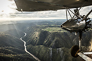 December 16, 2016<br /> A 1928 Ford Tri-Motor airplane flies over the Wild &amp; Scenic Tuolumne River, located near Yosemite National Park on Friday, December 16, 2016.<br /> <br /> This Ford Tri-Motor NC9645, nicknamed The Tin Goose, has a wingspan of 77 feet 6 inches and was constructed in 1928. It was named the City of Wichita, and it was used to introduce the first coast-to-coast passenger air/rail service in the United States on July 7, 1929, and the development and inauguration of the first all air passenger service on October 25, 1930. This Tri-Motor can carry up to 10 passengers, and every seat is a window seat.<br /> <br /> Experimental Aircraft Association (EAA) is a worldwide organization of aviation enthusiasts. EAA&rsquo;s 185,000 members and 1,000 local chapters enjoy sharing their passion for flying, building and restoring aircraft. Pine Mountain Lake&rsquo;s EAA Chapter 1337 is hosting the airline&rsquo;s visit.