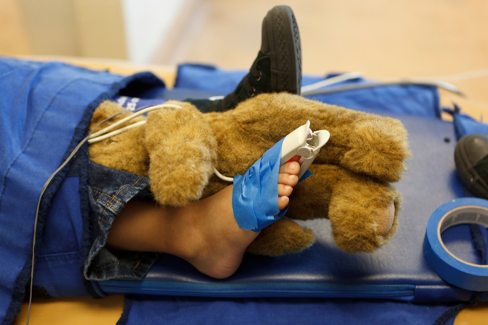 A teddy bear rests between a patient's feet Tuesday, Dec. 13, 2011, at Central Coast Pediatric Dental Group in Salinas, California.