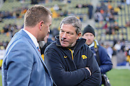 October 10, 2009: Iowa head coach Kirk Ferentz talks with ESPN's Kirk Herbstreit (from right) before the Iowa Hawkeyes' 30-28 win over the Michigan Wolverine's at Kinnick Stadium in Iowa City, Iowa on October 10, 2009.
