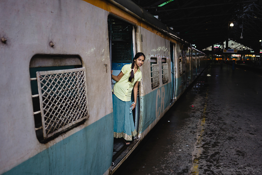 A young woman waiting for her train to depart from Mumbai's Chhatrapati Shivaji Terminus