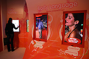A woman is interacting with the screens on the wall at the entrance of Amora, the Academy of Sex and Relationships, on Tuesday, April 17, 2007, in London, UK. The world's first visitor attraction dedicated to love, sex and relationships opens its door officially tomorrow (18th of April 2007) in Piccadilly. The permanent interactive attraction, Amora, expects to draw over half a million, 18+ visitors in the first year and fuses entertainment, excitement and education in a unique powerful sensory experience. With seven zones covering every aspect of relationships from first filtrations and dating to fantasy and fetish. Visitors can explore the science of attraction - what they find attractive and why, learn how to enhance their skills and even create what their perfect partner might look like. Male and female models help demystify erogenous zones, G-spot and prostate, while insights and technique tips are offered on various topics. Sexual awareness and well-being are also covered thoroughly. **Italy Out**..