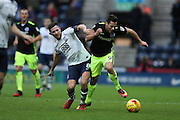 Brighton & Hove Albion centre forward Sam Baldock (9) and Preston North End midfielder Alan Browne (8) during the EFL Sky Bet Championship match between Preston North End and Brighton and Hove Albion at Deepdale, Preston, England on 14 January 2017.