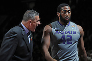 MANHATTAN, KS - JANUARY 07:  Head coach Frank Martin (R) of the Kansas State Wildcats reacts to forward Thomas Gipson #32 as he comes to the bench against the Missouri Tigers during the second half on January 7, 2012 at Bramlage Coliseum in Manhattan, Kansas.  (Photo by Peter G. Aiken/Getty Images) *** Local Caption *** Frank Martin;Thomas Gipson