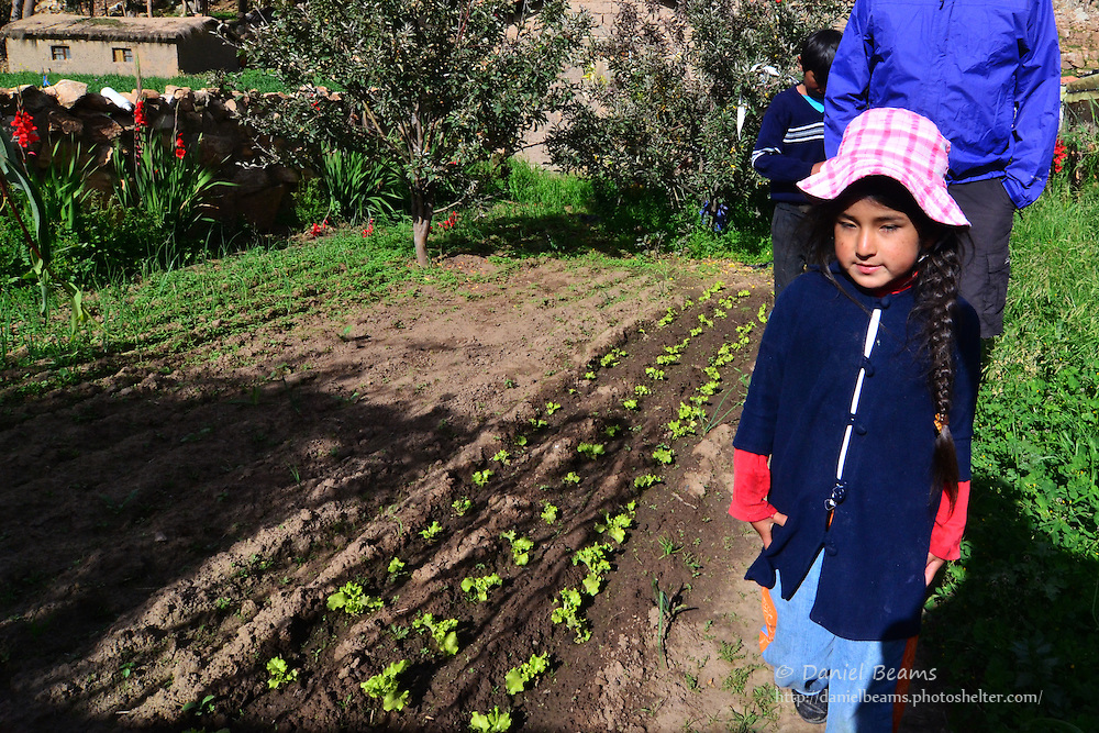 Quechua girl in garden at 12,000 ft in the Andes, Cochabamba, Bolivia