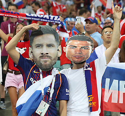 SOCHI, July 7, 2018  Fans with masks of Portugal's Cristiano Ronaldo (R) and Argentina's Lionel Messi are seen prior to the 2018 FIFA World Cup quarter-final match between Russia and Croatia in Sochi, Russia, July 7, 2018. (Credit Image: © Cao Can/Xinhua via ZUMA Wire)