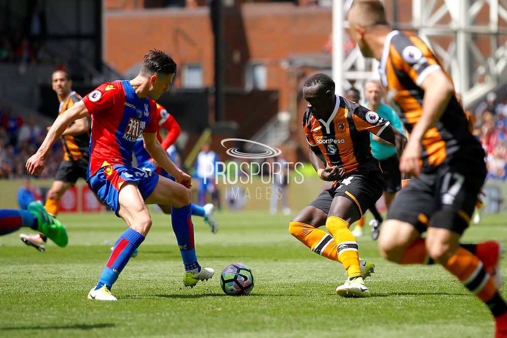 Crystal Palace defender Martin Kelly gets a tackle in against Hull City Forward Oumar Niasse during the Premier League match between Crystal Palace and Hull City at Selhurst Park, London, England on 14 May 2017. Photo by Andy Walter.