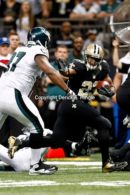 November 5, 2012; New Orleans, LA, USA; New Orleans Saints running back Pierre Thomas (23) is chased by Philadelphia Eagles defensive tackle Cullen Jenkins (97) during the first half of a game at the Mercedes-Benz Superdome. Mandatory Credit: Derick E. Hingle-US PRESSWIRE