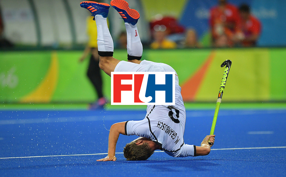 TOPSHOT - Germany's Mats Grambusch falls during the men's field hockey Canada vs Germany match of the Rio 2016 Olympics Games at the Olympic Hockey Centre in Rio de Janeiro on August, 6 2016. / AFP / Carl DE SOUZA        (Photo credit should read CARL DE SOUZA/AFP/Getty Images)