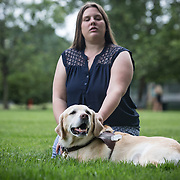 ARLINGTON, VA -JUNE3:  Tiffany Jolliff and her assistance dog, Railey, outside her apartment in Arlington, VA, June 3, 2016. The Washington Lawyers' Committee for Civil Rights and Urban Affairs filed a lawsuit Thursday in federal district court in the Eastern District of Virginia on behalf of Tiffany Jolliff against Uber, alleging violations of the Americans With Disabilities Act and the Virginians with Disabilities Act, alleging Uber unlawfully refused to accommodate Jolliff, who is blind, and her service dog, Railey. The complaint alleges that Jolliff, who works as a policy specialist for the federal government on employment for workers with disabilities, has been repeatedly discriminated against and denied Uber's services when Uber's drivers have seen that she is accompanied by her service dog Railey. Specifically, instead of accommodating her service dog Railey, as both the ADA and VDA require, Uber drivers have repeatedly driven off upon seeing that Ms. Jolliff had a service dog. (Photo by Evelyn Hockstein/For The Washington Post)