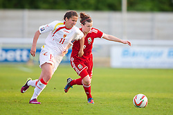 BANGOR, WALES - Thursday, May 8, 2014: Wales' Hayley Ladd in action against Montenegro's Armisa Kuc during the FIFA Women's World Cup Canada 2015 Qualifying Group 6 match at the Nantporth Stadium. (Pic by David Rawcliffe/Propaganda)
