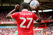Nottingham Forest defender Tendayi Darikwa (27) prepares to take a throw during the EFL Sky Bet Championship match between Nottingham Forest and Reading at the City Ground, Nottingham, England on 11 August 2018.