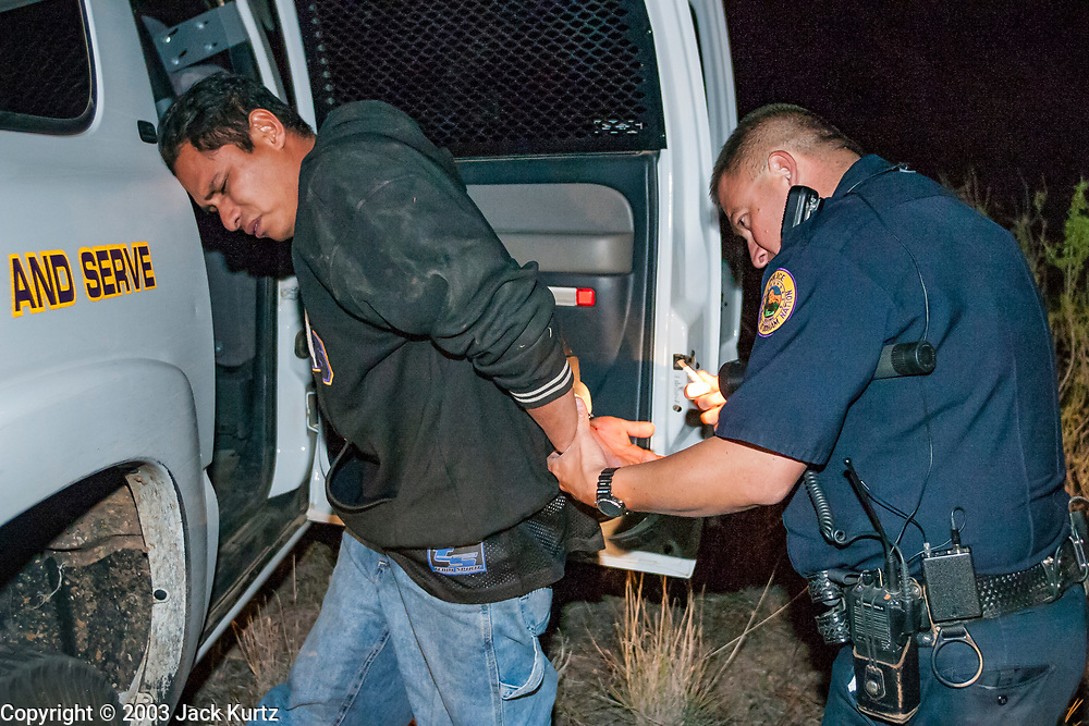 21 APRIL 2003 - SELLS, ARIZONA: Undocumented immigrants in custody of the Tohono O'Odham police department on patrol looking for undocumented immigrants who enter the US through the reservation.     PHOTO BY JACK KURTZ
