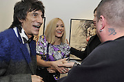 RONNIE WOOD; FEARNE COTTON; ;, Faces, Time and Places. Symbolic Collection & Ronnie Wood private view, Cork St. London. 8 November 2011.<br /> <br /> <br />  , -DO NOT ARCHIVE-© Copyright Photograph by Dafydd Jones. 248 Clapham Rd. London SW9 0PZ. Tel 0207 820 0771. www.dafjones.com.