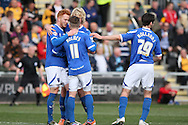 Ryan Taylor of Portsmouth (l) celebrates scoring his side's first goal from the penalty spot with team-mates. Skybet football league two match, Newport county v Portsmouth at Rodney Parade in Newport, South Wales on Saturday 29th March 2014.<br /> pic by Mark Hawkins, Andrew Orchard sports photography.