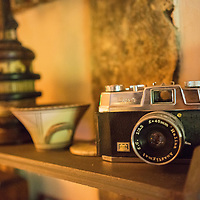 Vintage camera on shelf in old cottage in England
