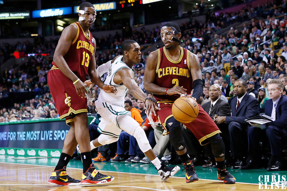 19 December 2012: Cleveland Cavaliers point guard Kyrie Irving (2) drives past Boston Celtics point guard Rajon Rondo (9) on a screen set by Cleveland Cavaliers power forward Tristan Thompson (13) during the Boston Celtics 103-91 victory over the Cleveland Cavaliers at the TD Garden, Boston, Massachusetts, USA.
